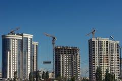 Inre ställe för många högväxta byggnader under konstruktion Arkivbild