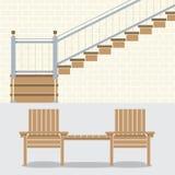 Inre tegelstenvägg med trappa och trästolar Arkivbild