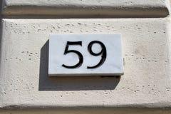 Inristat byggnadsnummer royaltyfri bild