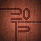 Inristat 2015 typografiska design för lyckligt nytt år på wood texturbakgrund Fotografering för Bildbyråer