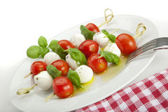 Insalata caprese sticks on plate, tilted view stock photos