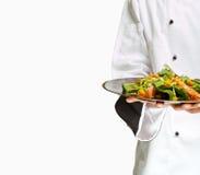 Insalata della holding del cuoco unico Immagine Stock