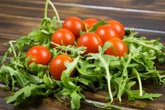Insalata della rucola con i pomodori Fotografia Stock