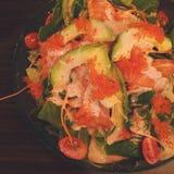 Insalata di color salmone con l'avocado Fotografia Stock