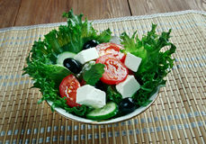 Insalata di misticanze. Leaves of different salads with vegetables and Sicilian tomatoes Stock Image