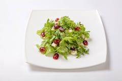 Insalata fresca di lattuga con salsa dolce con i pezzi di frutta Fotografie Stock