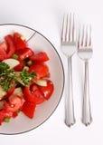 Insalata rossa del prezzemolo e del pomodoro isolata su bianco Immagine Stock