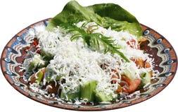 Insalata tradizionale con i pomodori, il formaggio ed i peperoni Fotografia Stock