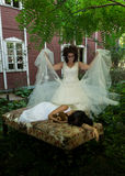 Insane bride and lying victim Royalty Free Stock Images