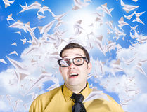 Insane business man with busy travel schedule. Hectic travelling business man swamped with heaps of planes to catch when dealing with an intense flight plan Royalty Free Stock Images