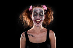 Insane female clown in front of black Stock Images