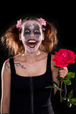 Insane funny female clown with red rose Royalty Free Stock Photos