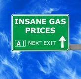 INSANE GAS PRICES road sign against clear blue sky stock images
