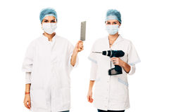 Insane hospital employees. Two of an insane hospital's employees holding an electric drill and a cleaver - isolated on white Royalty Free Stock Images