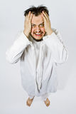 Insane man in strait-jacket Stock Images