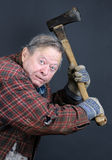 Insane old man with axe. Very scary crazy old man or senior making face and threatening with an axe, great details, can be holloween or other horror scene Royalty Free Stock Images
