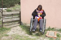 Insane woman on wheelchair. Insane woman moving on wheelchair royalty free stock photos