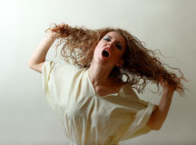 Insane woman screaming Royalty Free Stock Image
