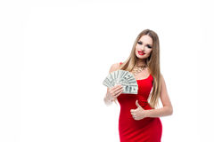 Insanely beautiful young woman in red dress holding a lot of 100 dollar bills and showing thumbs up all okay