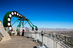 Insanity Ride on top of the Stratosphere, Las Vegas, NV. Brave people ride the famed Insanity ride extending beyond the building over 1100 feet above ground Royalty Free Stock Image