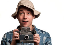 Insant camera man. Man holding a instant camera on a white background Stock Photos