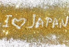 Inschrijving I liefde Japan op gouden schittert fonkelingen op witte achtergrond Stock Afbeelding