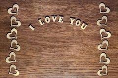 Inschrijving I Liefde u op houten achtergrond Stock Foto's
