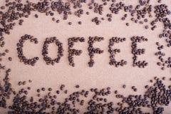 Inschrijving van koffie met koffiebonen Royalty-vrije Stock Foto's