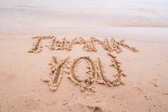 Inschrijvingen op het zand: Dank u Royalty-vrije Stock Fotografie