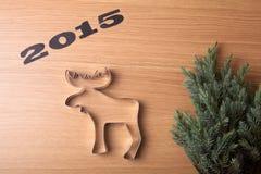 Inschrijvings 2015 Kerstboom en vorm van Amerikaanse elanden op houten t Stock Afbeeldingen