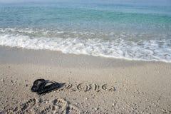 Inscrição 2016 da escrita na praia Foto de Stock