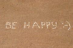Inscrição do divertimento na areia fotografia de stock