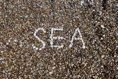 Inscrição do mar em uma praia Imagens de Stock Royalty Free