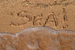 Inscrição na areia imagens de stock