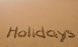 A inscrição na areia - feriados Fotos de Stock Royalty Free