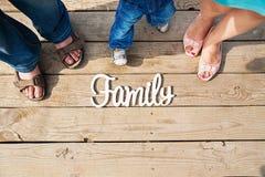 A inscrição na natureza da família de três pessoas da ponte fotografia de stock royalty free