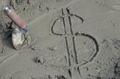 Inscrição o dólar no cimento com pá de pedreiro Imagem de Stock