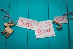 inscripción de la Feliz Año Nuevo en fondo de madera Fotografía de archivo libre de regalías