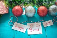inscripción de la Feliz Año Nuevo en fondo de madera Imagen de archivo libre de regalías
