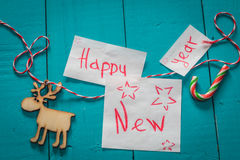 inscripción de la Feliz Año Nuevo en fondo de madera Imagen de archivo