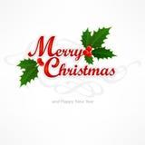 Inscripción de la Feliz Navidad con la baya del acebo Imagen de archivo libre de regalías