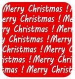 Inscripción de la Feliz Navidad, en fondo rojo Imágenes de archivo libres de regalías
