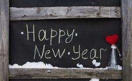 Inscripción de la tiza del Grunge en la Feliz Año Nuevo del tablero Fotos de archivo libres de regalías
