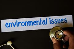 Inscripción de los aspectos medioambientales con la vista del estetoscopio imágenes de archivo libres de regalías