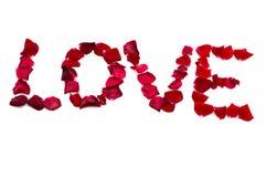 Inscripción del amor de los pétalos color de rosa rojos Fotografía de archivo libre de regalías