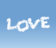 Inscripción del amor de un clodulet Imágenes de archivo libres de regalías