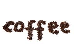 Inscripción del café hecha con los granos de café Foto de archivo libre de regalías