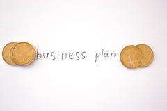 Inscripción del plan empresarial con las monedas Fotos de archivo