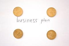 Inscripción del plan empresarial con las monedas Imagen de archivo libre de regalías