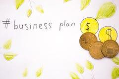 Inscripción del plan empresarial con las monedas Imagen de archivo